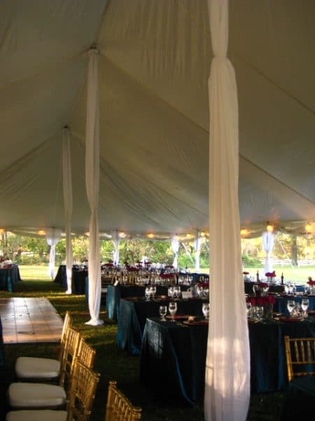 Interior of Pole Tent with aluminum center poles and legs covered by draping & Wedding Tents Rentals | A Grand Event