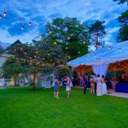 Bistro Lights outside White Structure Tent